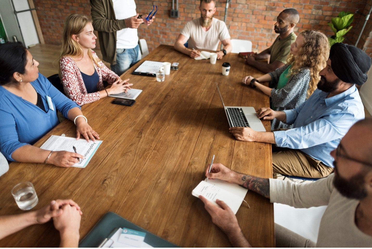 people sitting around conference table